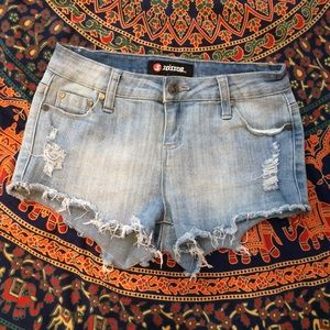 distressed scissor jean shorts